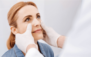 Woman getting checked for plastic surgery